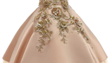 صورة تفسير حلم لبس فستان ذهبي للعزباء والمتزوجة